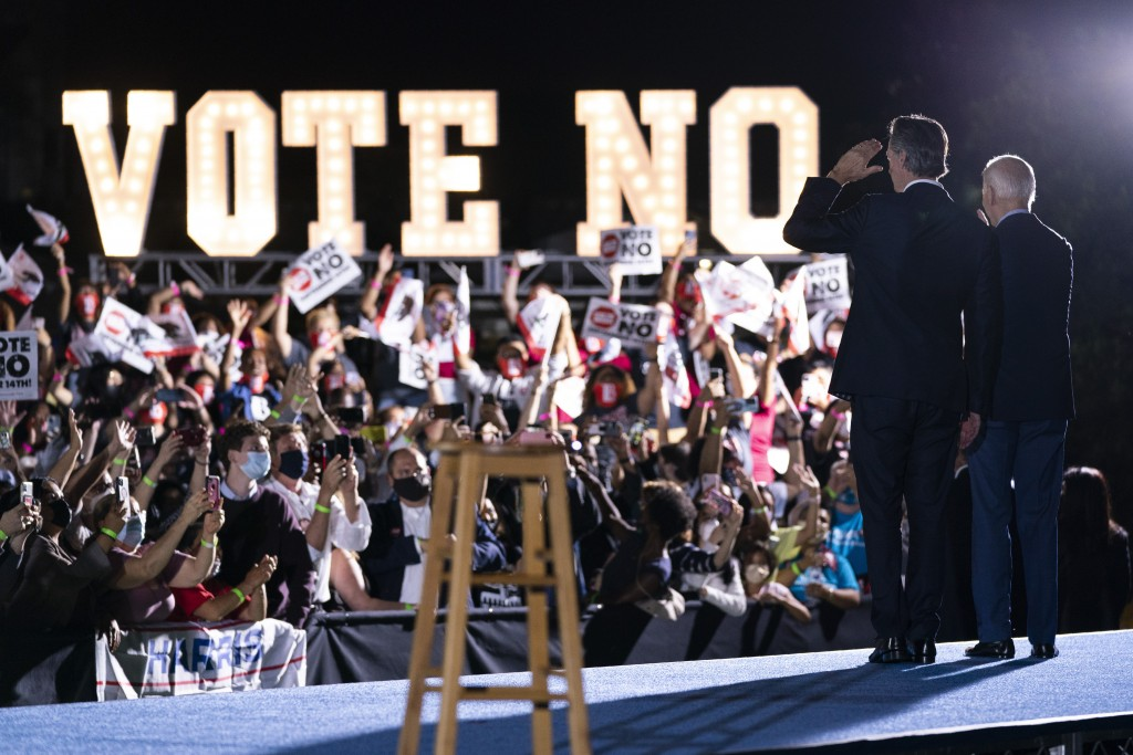 President Joe Biden stands with Gov. Gavin Newsom, D-Calif., during a get out the vote rally at at Long Beach City College, Monday, Sept. 13, 2021, in...
