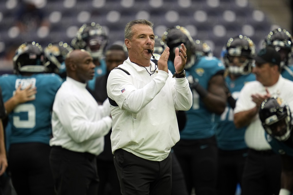 Jacksonville Jaguars coach Urban Meyer blows his whistle before an NFL football game against the Houston Texans Sunday, Sept. 12, 2021, in Houston. (A...