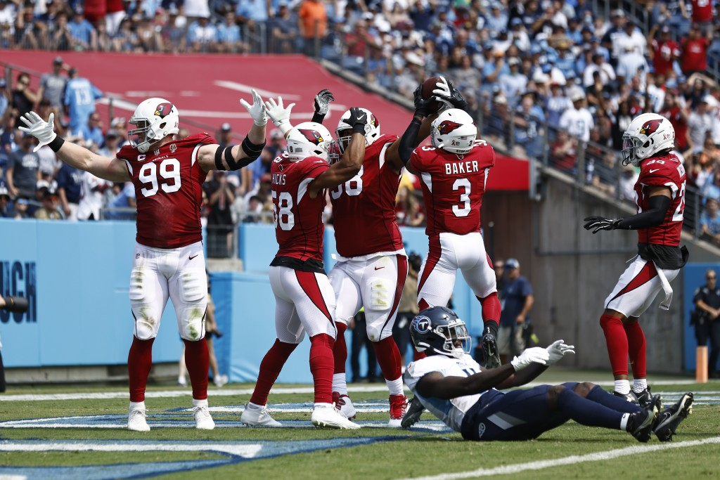 Arizona Cardinals defensive end J.J. Watt (99) celebrates after teammate Corey Peters, third from left, recovered a Tennessee Titans fumble in the fir...