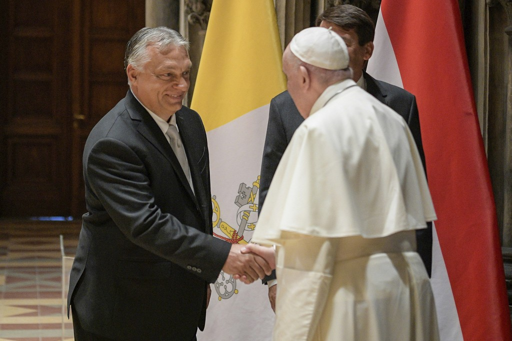 Pope Francis shakes hands with Hungarian Prime Minister Viktor Orban at Budapest's Museum of Fine Arts, Sunday, Sept. 12, 2021. Francis is opening his...