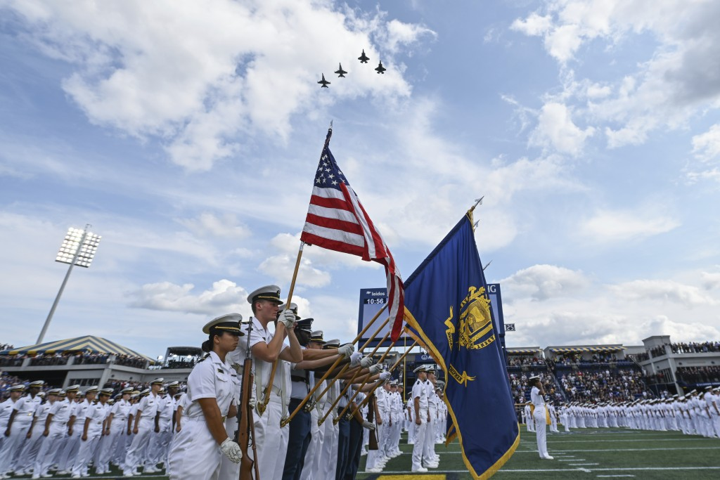 The Brigade of Midshipmen stand at attention during the National Anthem before an NCAA college football game between Navy and Air Force, Saturday, Sep...