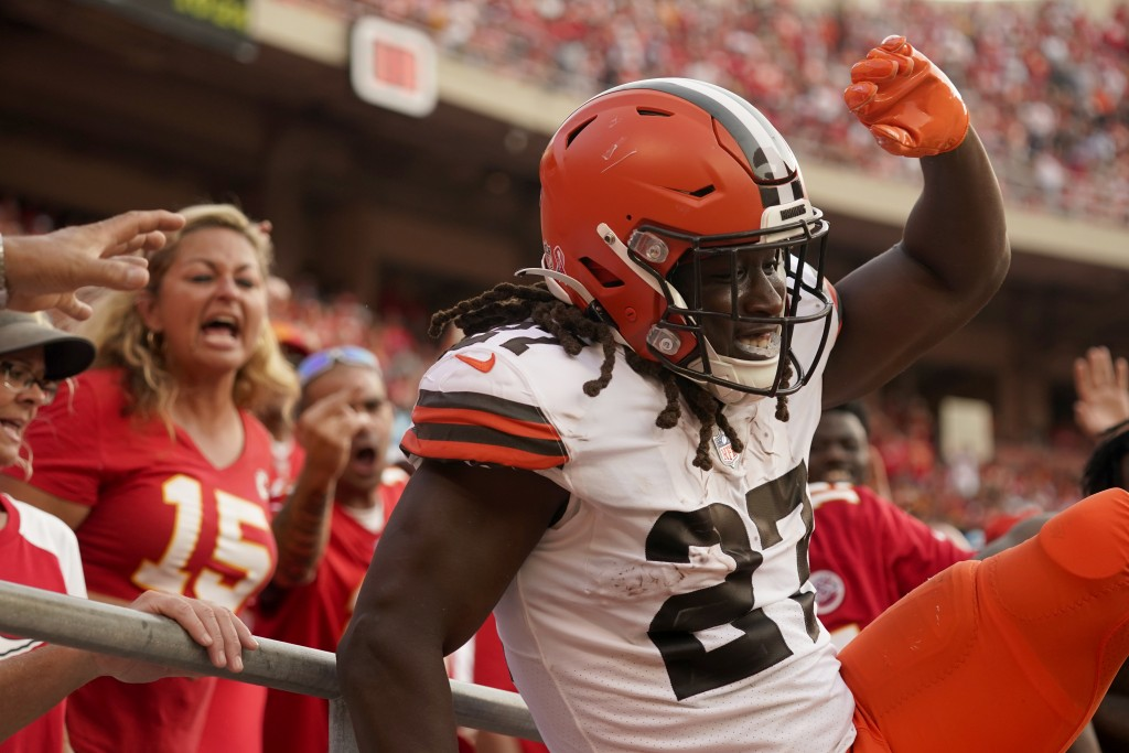 Cleveland Browns running back Kareem Hunt celebrates after scoring during the second half of an NFL football game against the Kansas City Chiefs Sunda...