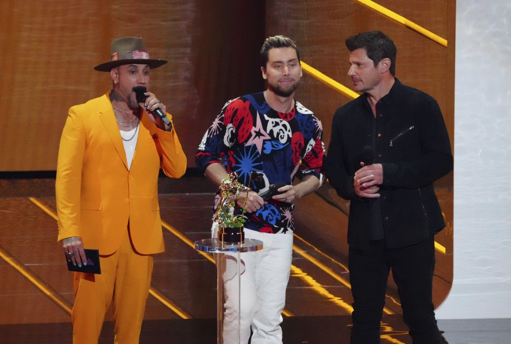 AJ McLean, from left, Lance Bass and Nick Lachey present the award for best K-pop at the MTV Video Music Awards at Barclays Center on Sunday, Sept. 12...