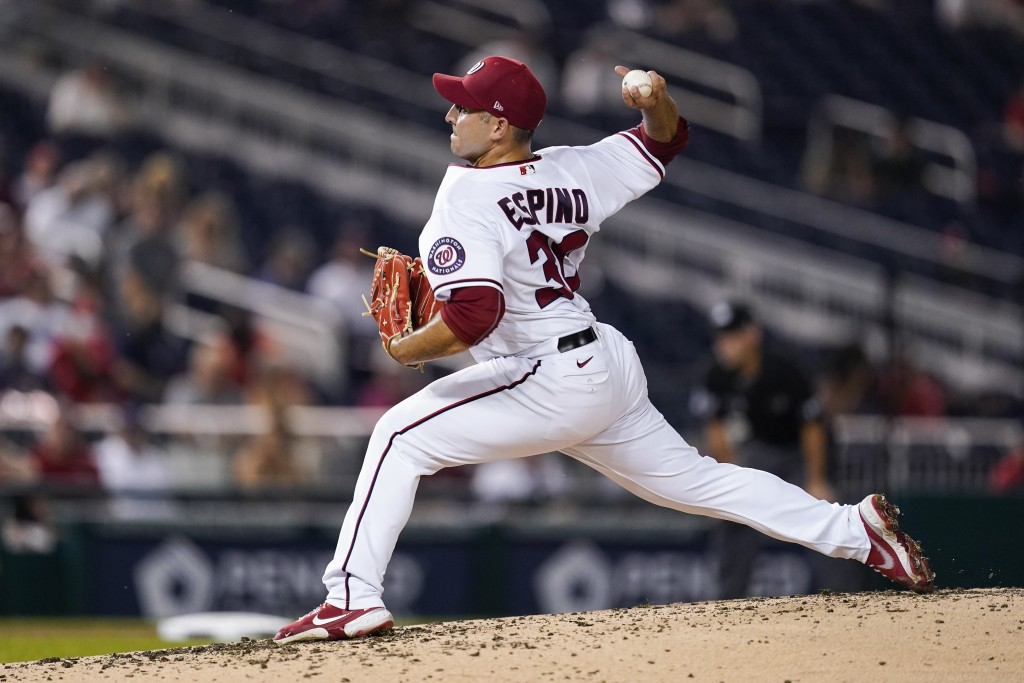 Washington Nationals starting pitcher Paolo Espino throws during the third inning of a baseball game against the Miami Marlins at Nationals Park, Mond...