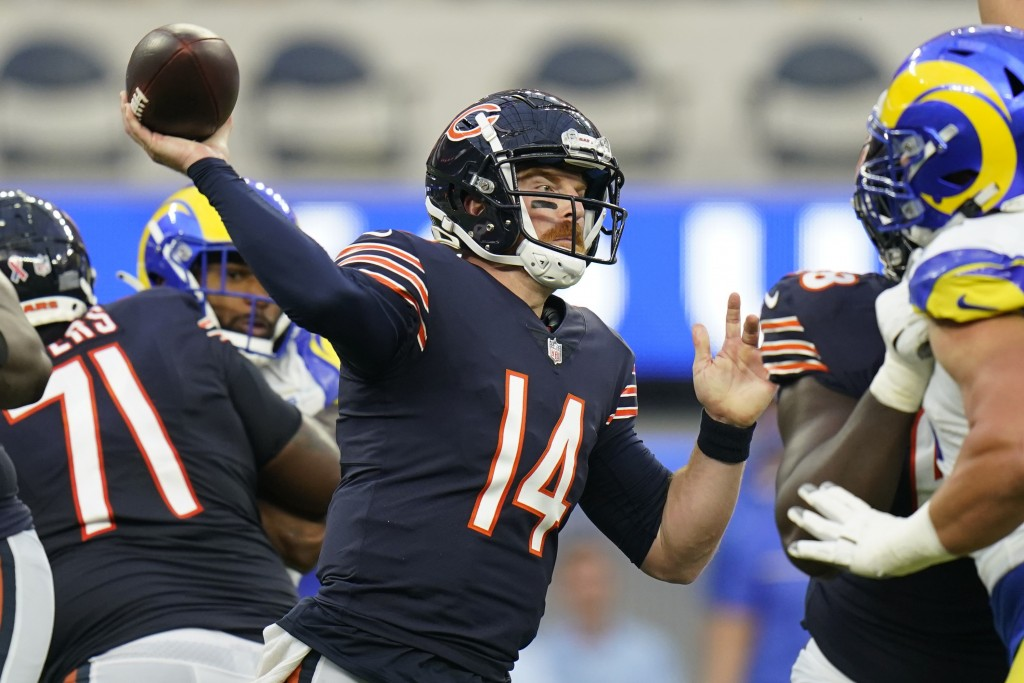 Chicago Bears quarterback Andy Dalton throws a pass during the first half of an NFL football game against the Los Angeles Rams, Sunday, Sept. 12, 2021...
