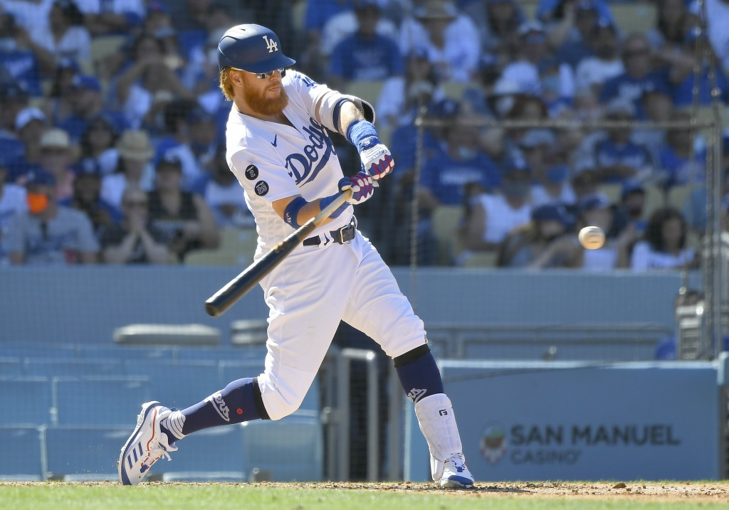 Los Angeles Dodgers' Justin Turner hits a three-run home run against the San Diego Padres in the seventh inning in a baseball game Sunday, Sept. 12, 2...