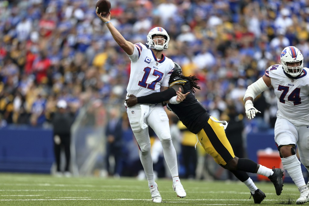 Buffalo Bills quarterback Josh Allen (17) gets off a pass as he is hit by Pittsburgh Steelers linebacker Melvin Ingram during the second half of an NF...