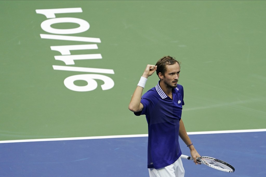 Daniil Medvedev, of Russia, reacts after scoring a point against Novak Djokovic, of Serbia, during the men's singles final of the US Open tennis champ...
