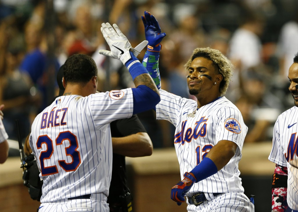 New York Mets' Javier Baez (23) congratulates Francisco Lindor after he hit a home run against the New York Yankees during the eighth inning of a base...