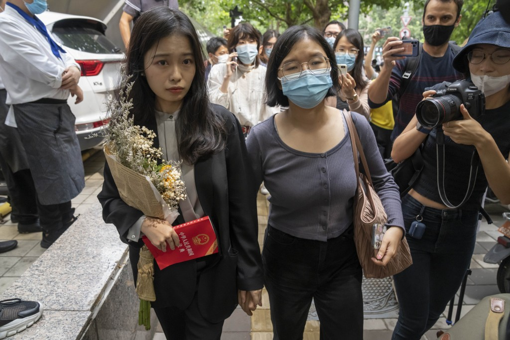 Zhou Xiaoxuan, left, a former intern at China's state broadcaster CCTV, arrives to attend a court session at a courthouse in Beijing, Tuesday, Sept. 1...
