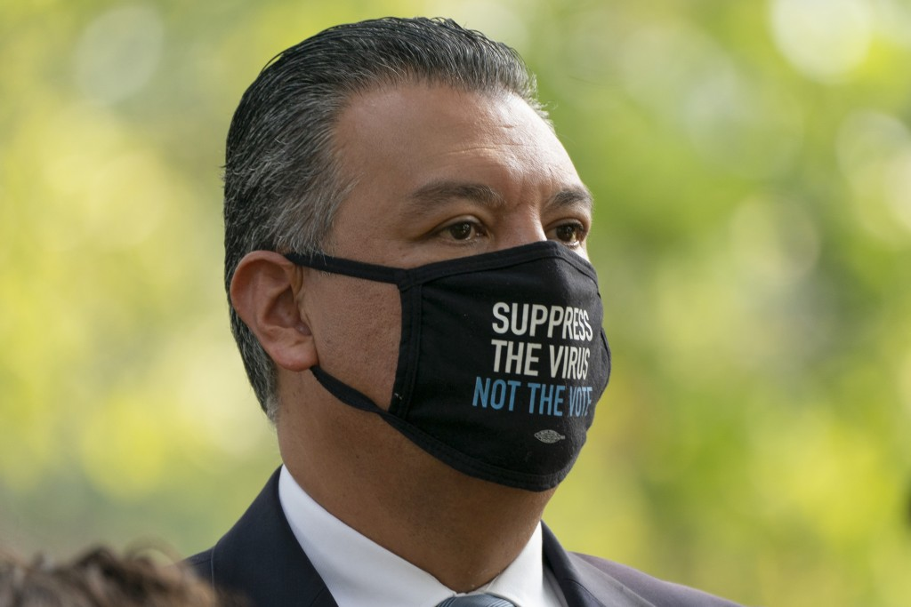 """Wearing a mask that says, """"Suppress the virus not the vote,"""" Sen. Alex Padilla, D-Calif., attends a rally for voting rights, Tuesday, Sept. 14, 2021, ..."""