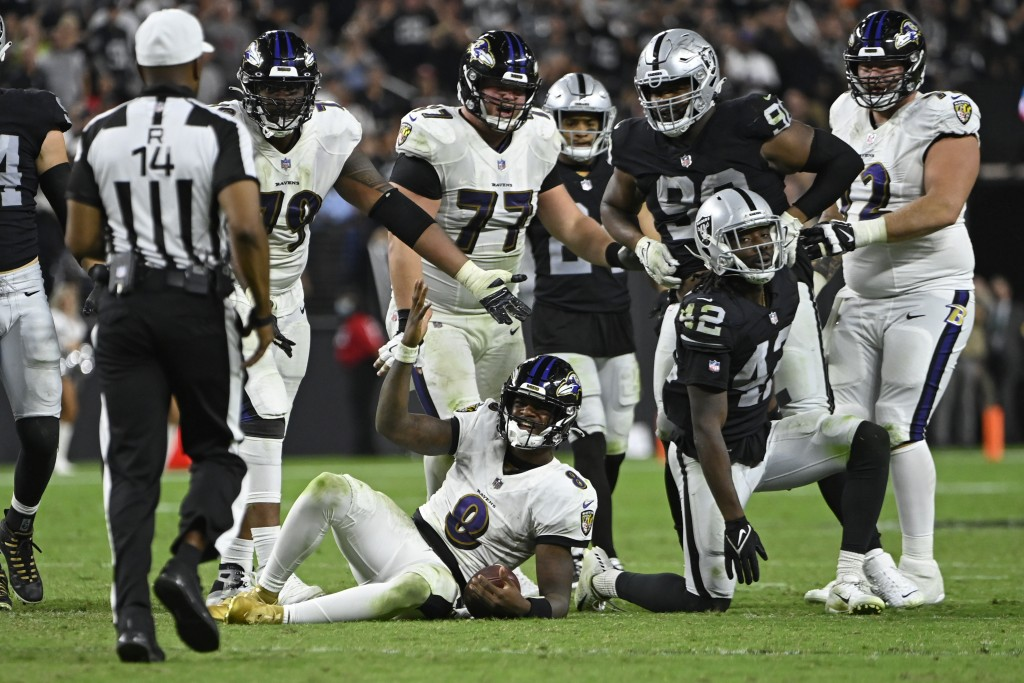 Baltimore Ravens quarterback Lamar Jackson (8) reacts after a play against the Las Vegas Raiders during the second half of an NFL football game, Monda...