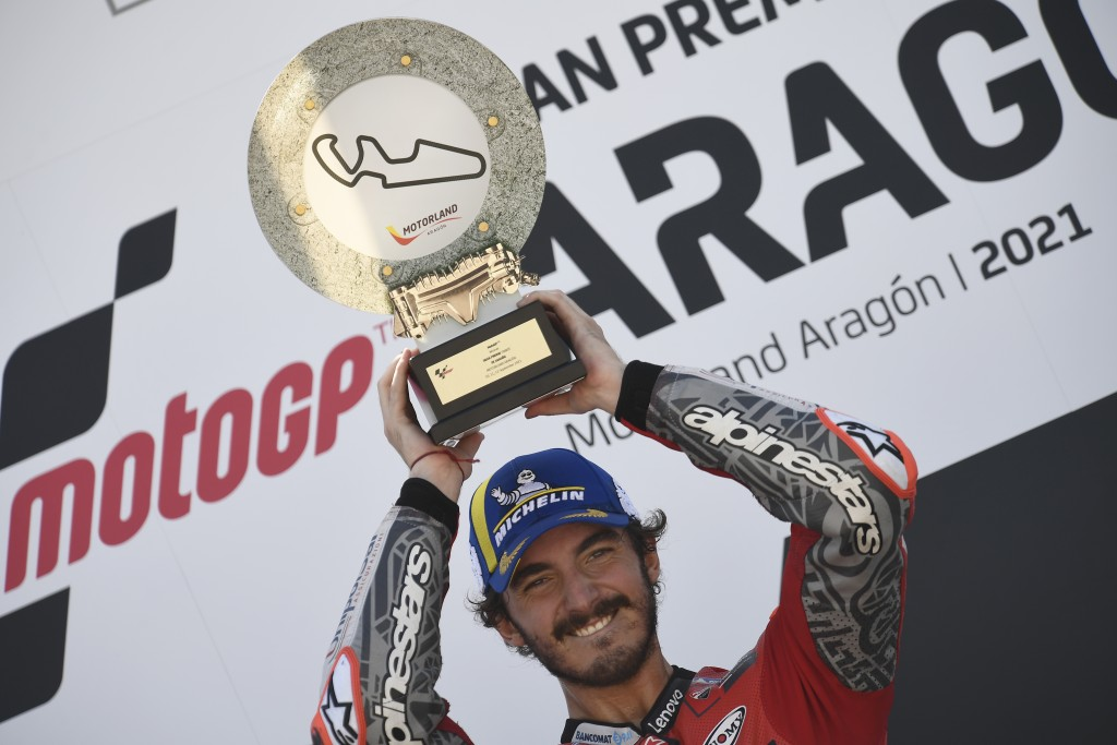 Francesco Bagnaia of Italy celebrates on the podium with his trophy after winning the Alcaniz Aragon Moto GP race at the MotorLand Aragon circuit, in ...