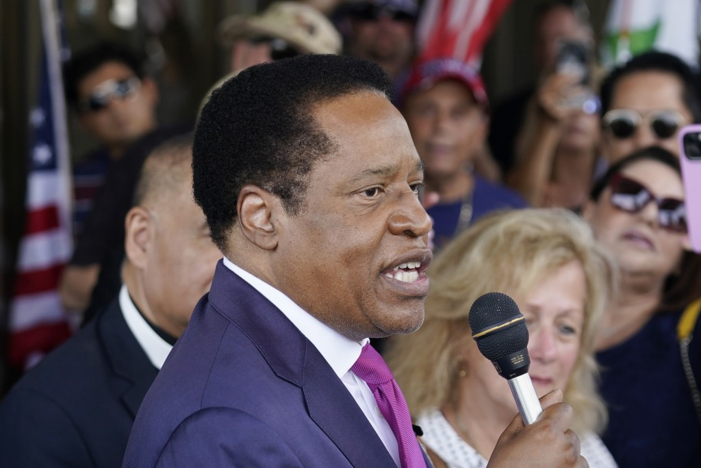 FILE - In this July 13, 2021, file photo, gubernatorial candidate and radio talk show host Larry Elder speaks to supporters during a campaign stop in ...