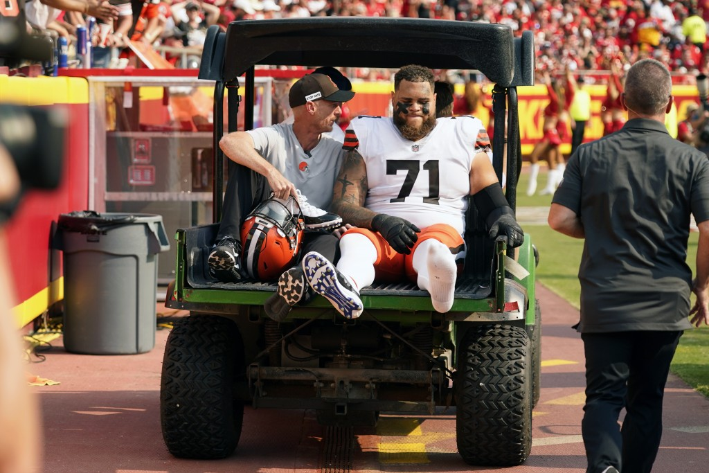 Cleveland Browns offensive tackle Jedrick Wills Jr. (71) is taken off on a cart during the first half of an NFL football game against the Kansas City ...