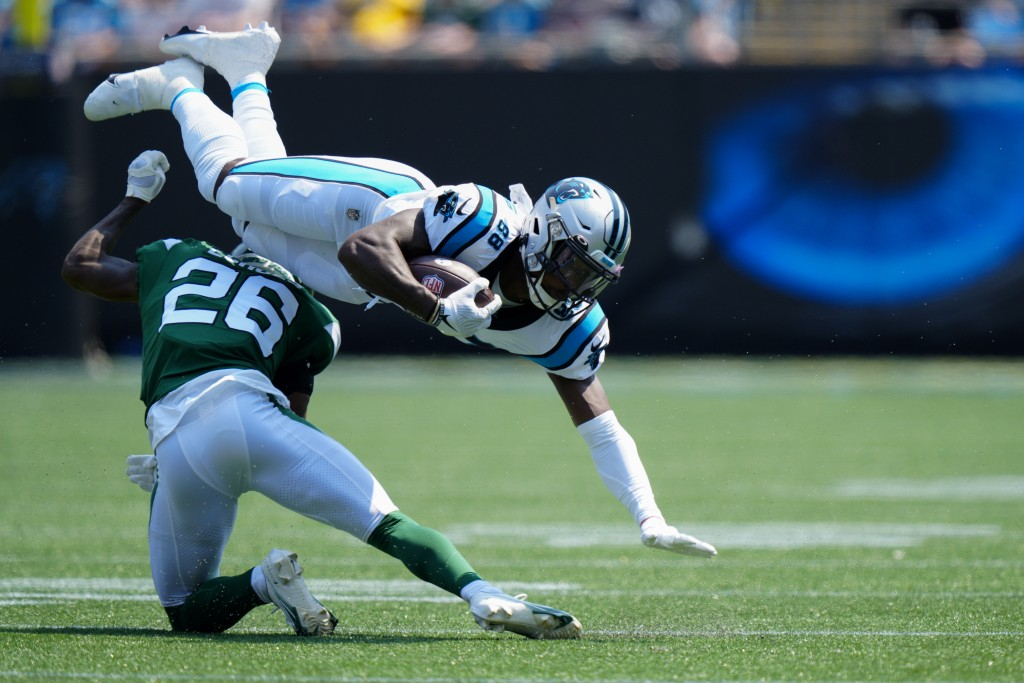 Carolina Panthers wide receiver Terrace Marshall Jr. is tackled by New York Jets cornerback Brandin Echols during the first half of an NFL football ga...