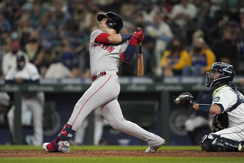 Boston Red Sox's Jose Iglesias hits an RBI single to score Alex Verdugo during the fifth inning of a baseball game against the Seattle Mariners, Monda...