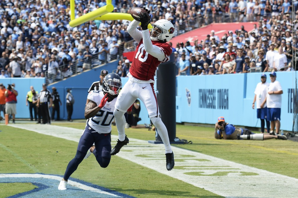 Arizona Cardinals wide receiver DeAndre Hopkins (10) catches a touchdown pass as he is defended by Tennessee Titans cornerback Jackrabbit Jenkins (20)...