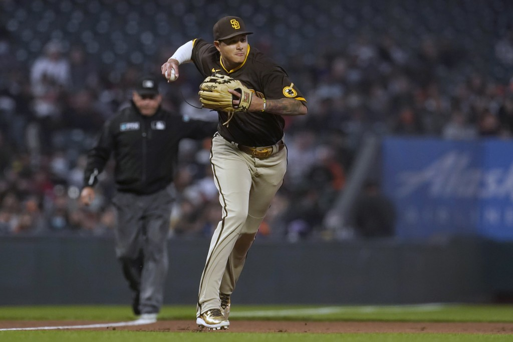 San Diego Padres third baseman Manny Machado throws out San Francisco Giants' Darin Ruf at first base during the second inning of a baseball game in S...