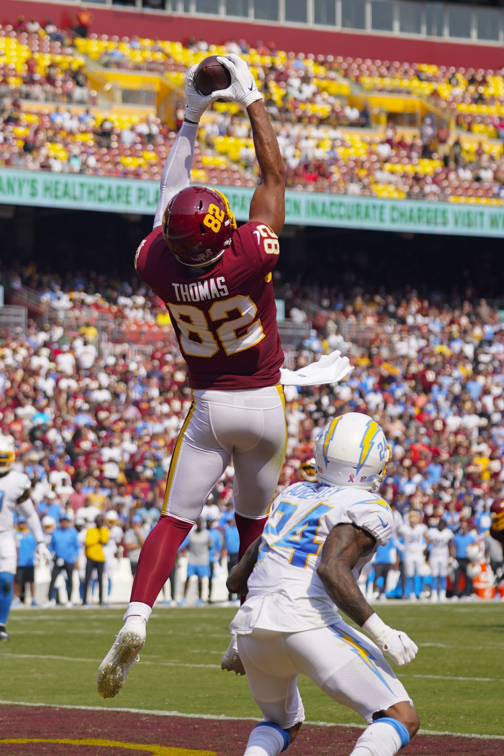 Washington Football Team tight end Logan Thomas (82) makes a touchdown catch against Los Angeles Chargers defensive back Nasir Adderley (24) during th...