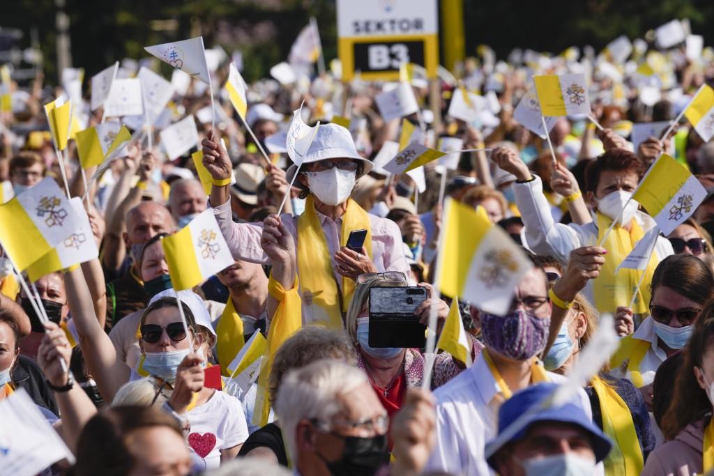 Faithful wave Vatican flags as Pope Francis arrives to celebrated a Byzantine rite Mass at Mestska sportova hala Square, in Presov, Slovakia, Tuesday,...
