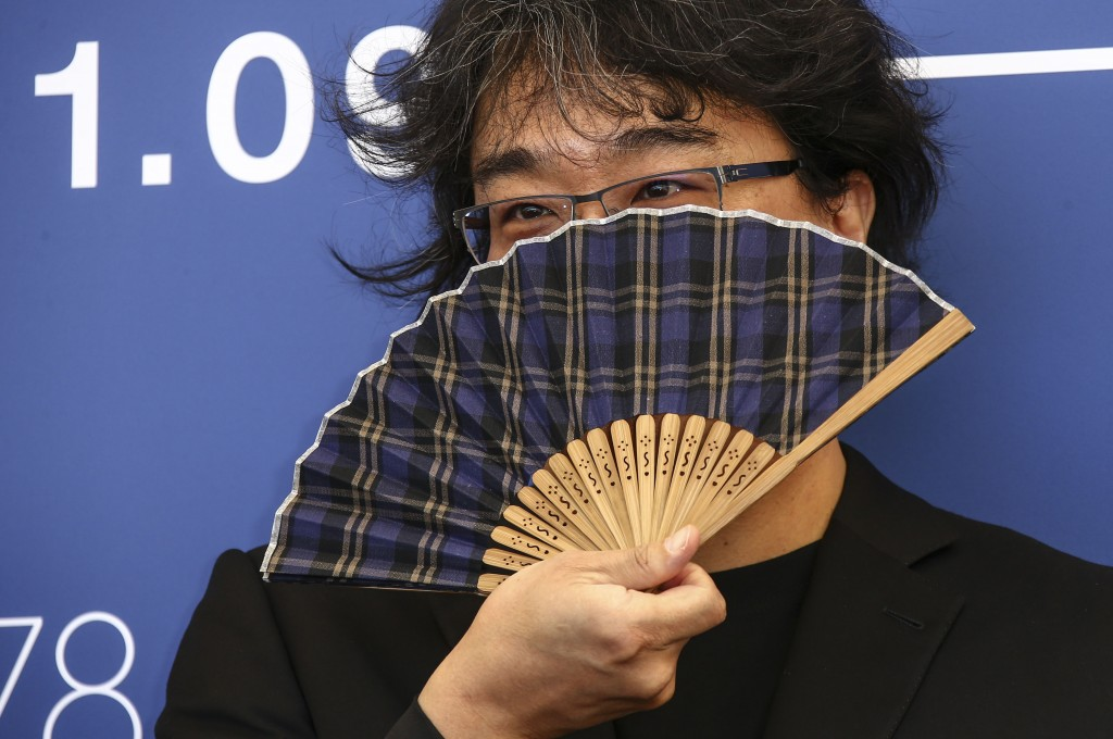 FILE - In this Sept, 1, 2021 file photo Jury president Bong Joon-ho poses for photographers at the photo call for the jury during the 78th edition of ...