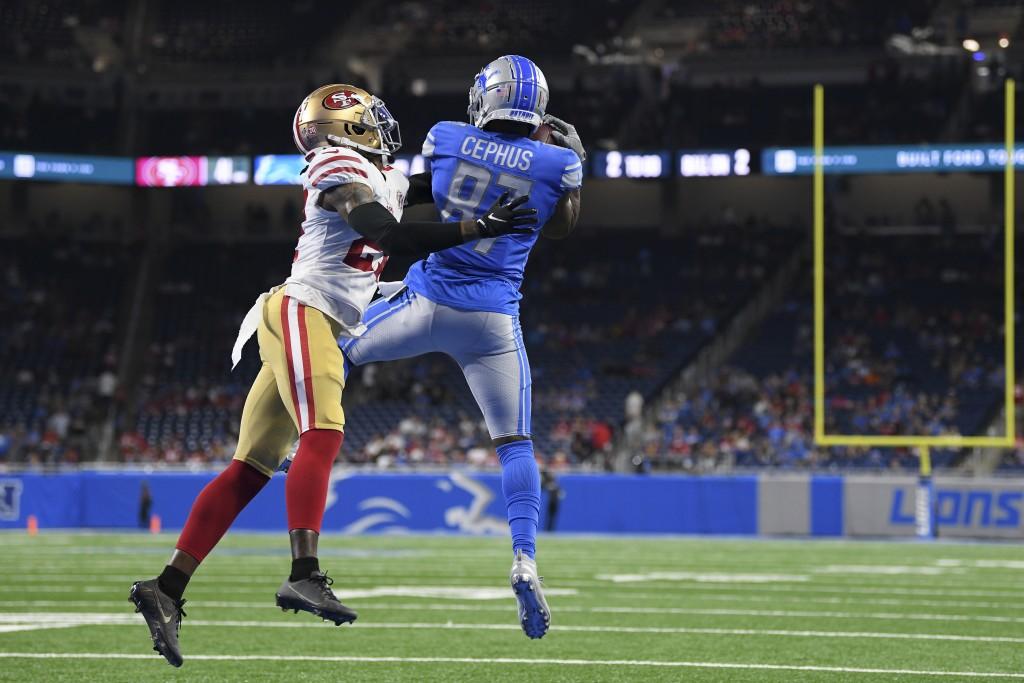 Detroit Lions wide receiver Quintez Cephus (87) catches a touchdown pass as San Francisco 49ers defensive back Dontae Johnson defends in the second ha...
