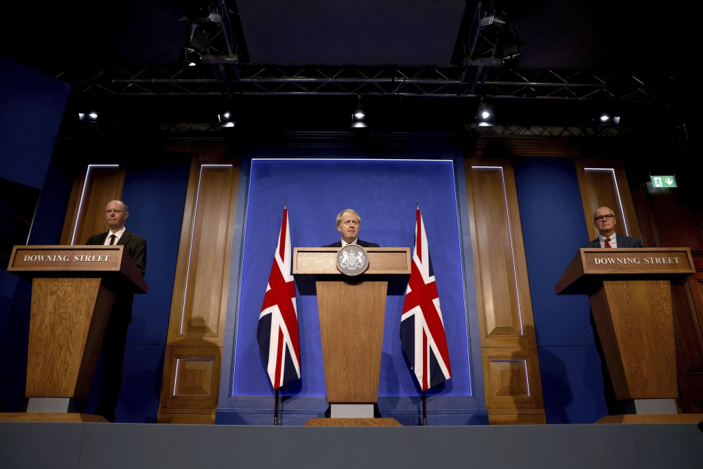 From left, Britain's Chief Medical Officer for England Chris Whitty, Prime Minister Boris Johnson and Chief Scientific Adviser Sir Patrick Vallance at...