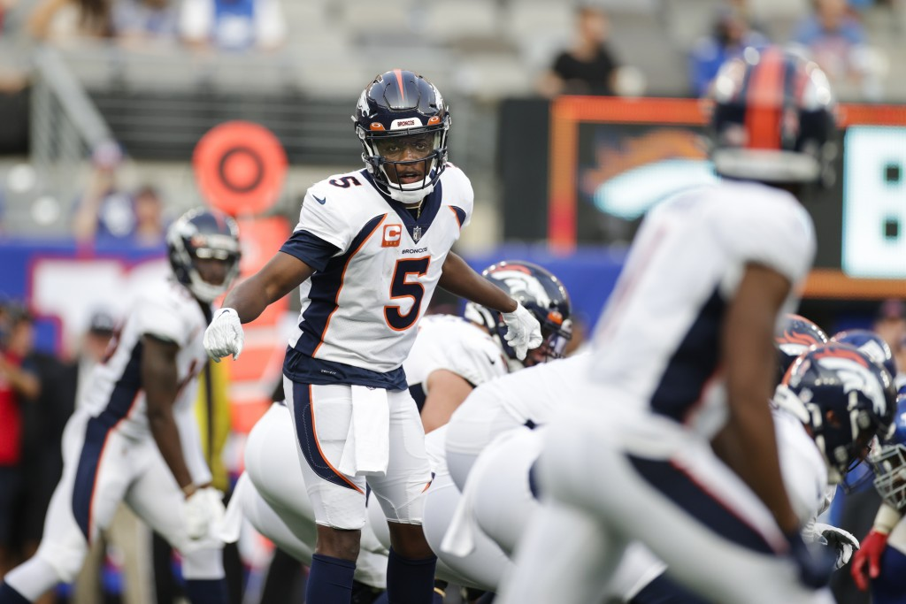 Denver Broncos quarterback Teddy Bridgewater (5) calls to teammates during the second half of an NFL football game against the New York Giants, Sunday...