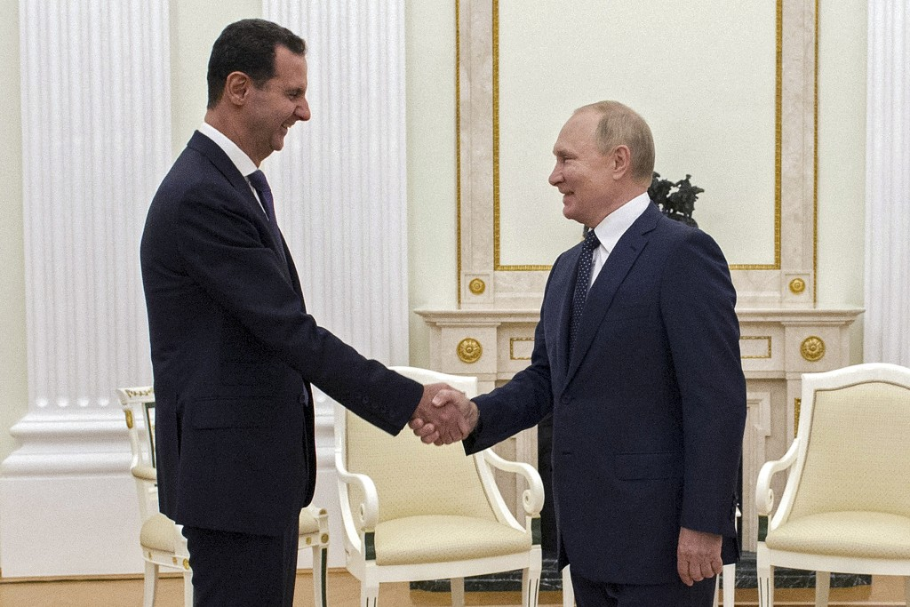 Russian President Vladimir Putin, right, greets Syrian President Bashar Assad during their meeting in the Kremlin in Moscow, Russia, Monday, Sept. 13,...