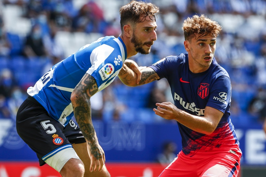 Atletico Madrid's Antoine Griezmann, right, in action next Espanyol's Fernando Calero during the Spanish La Liga soccer match between RCD Espanyol and...