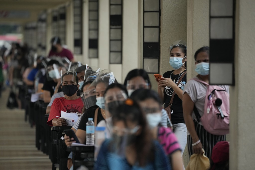 Residents wait for their turn at a vaccination center in Quezon city, Philippines on Monday, Sept. 13, 2021. The government continues to urge Filipino...