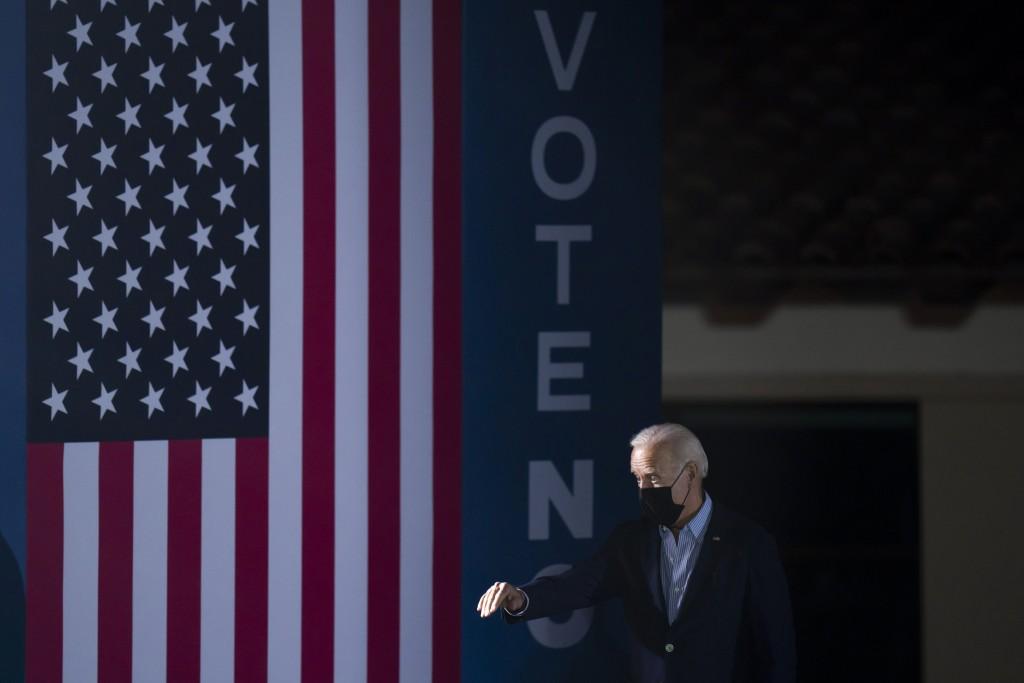President Joe Biden waves toward the crowd as he arrives at a rally to support California Gov. Gavin Newsom ahead of the California gubernatorial reca...