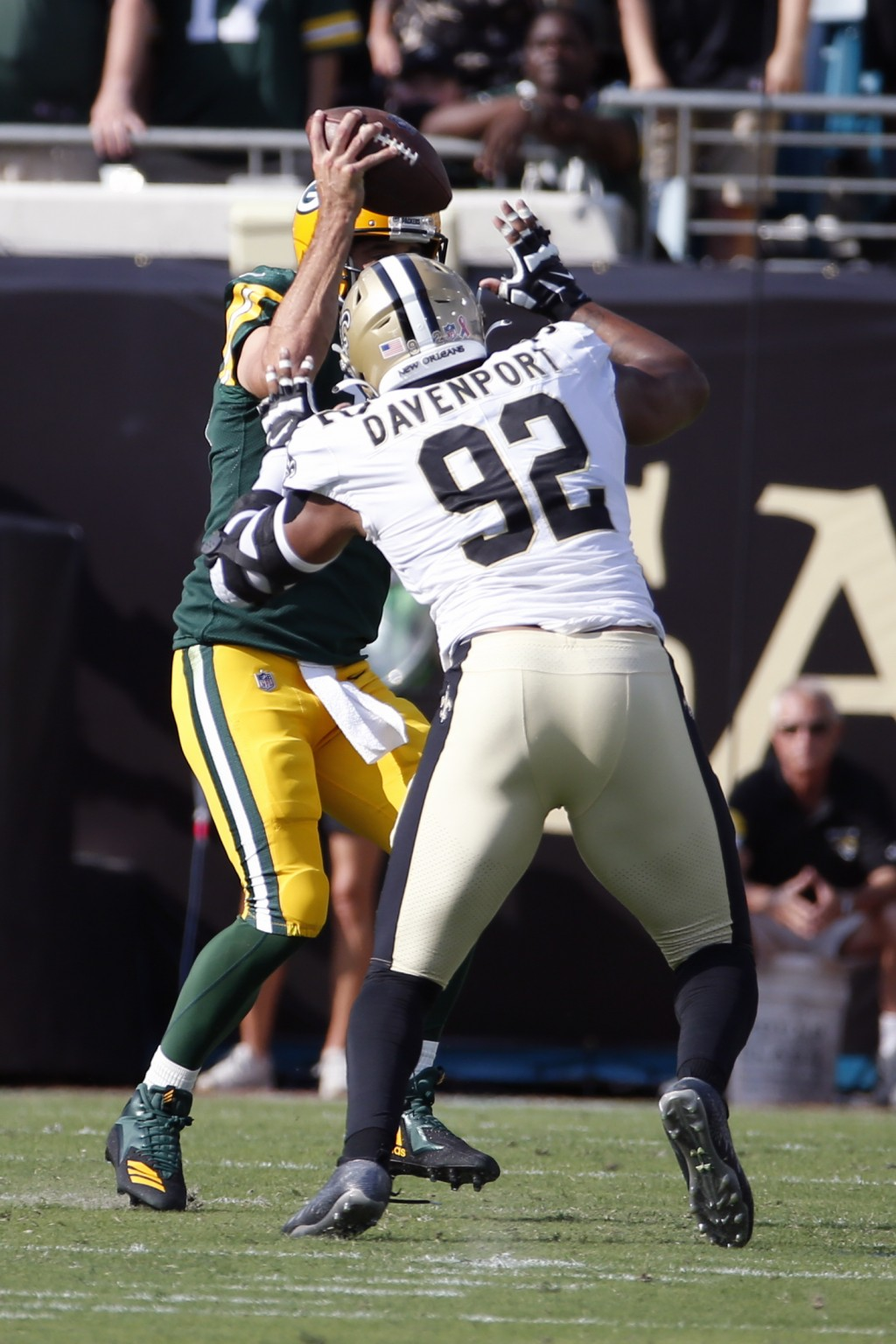 New Orleans Saints defensive end Marcus Davenport (92) sacks Green Bay Packers quarterback Aaron Rodgers during the first half of an NFL football game...
