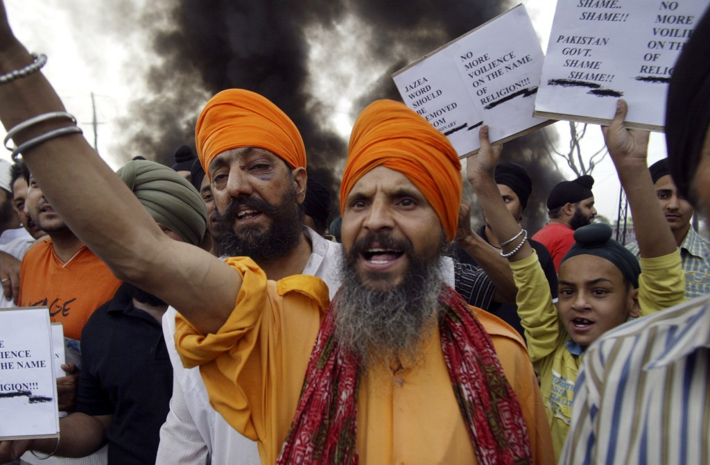 FILE - In this May 8, 2009, file photo, Sikh activists shout slogans against the Taliban and Pakistan to protest Taliban atrocities against Sikhs in P...