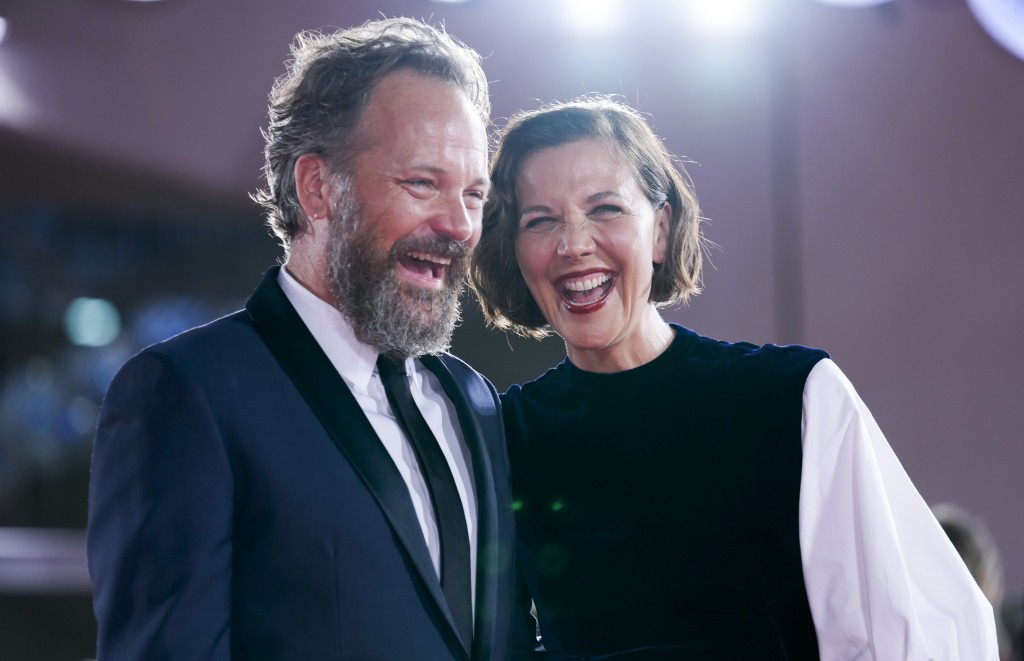 FILE - In this Sept, 3, 2021 file photo Peter Sarsgaard, left, and Maggie Gyllenhaal pose for photographers upon arrival at the premiere of the film '...