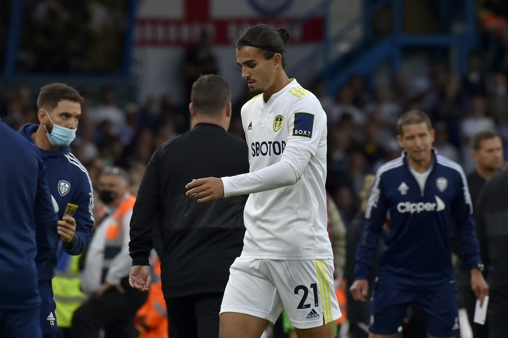 Leeds United's Pascal Struijk leaves the pitch after seeing a red card for a foul on Liverpool's Harvey Elliott during the English Premier League socc...