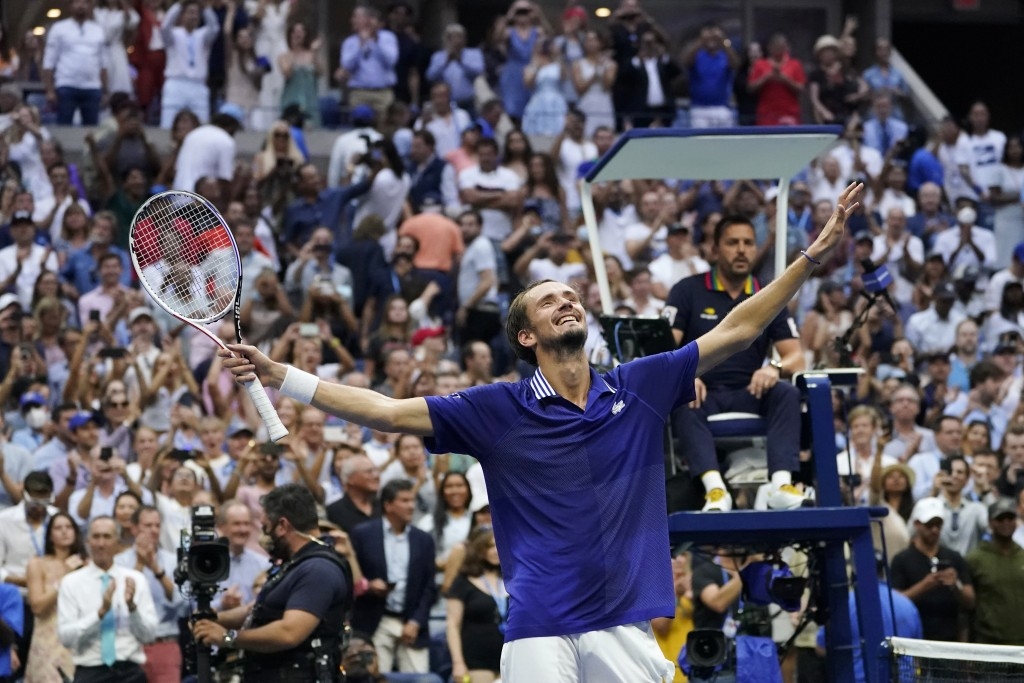 Daniil Medvedev, of Russia, reacts after defeating Novak Djokovic, of Serbia, in the men's singles final of the US Open tennis championships, Sunday, ...