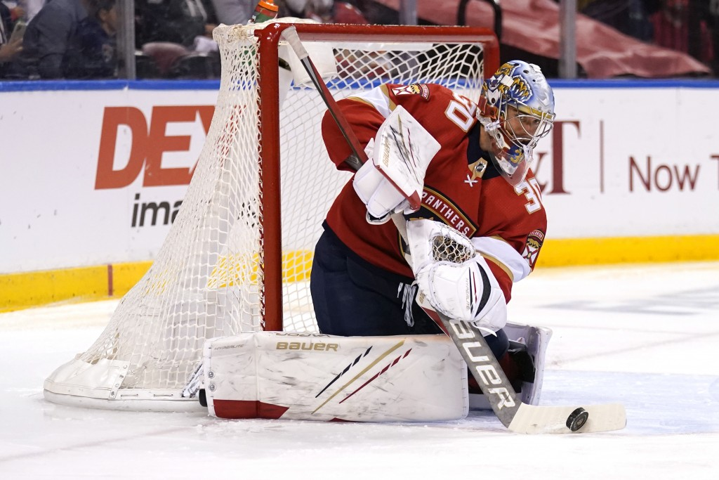 FILE - In this Monday, May 24, 2021, file photo, Florida Panthers goaltender Spencer Knight (30) stops a shot on the goal during the first period in G...