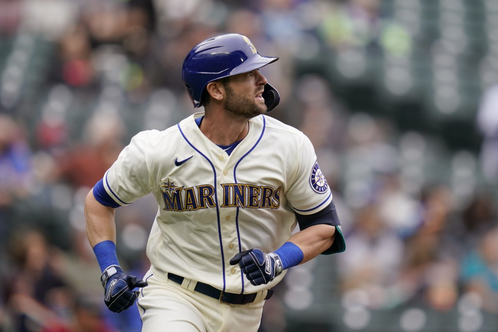 Seattle Mariners' Mitch Haniger watches the path of his solo home run against the Arizona Diamondbacks in the fourth inning of a baseball game Sunday,...