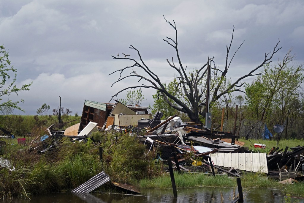 Storm clouds from Tropical Storm Nicholas are seen behind homes of the vanishing Native American community of Isle de Jean Charles, La., which were de...