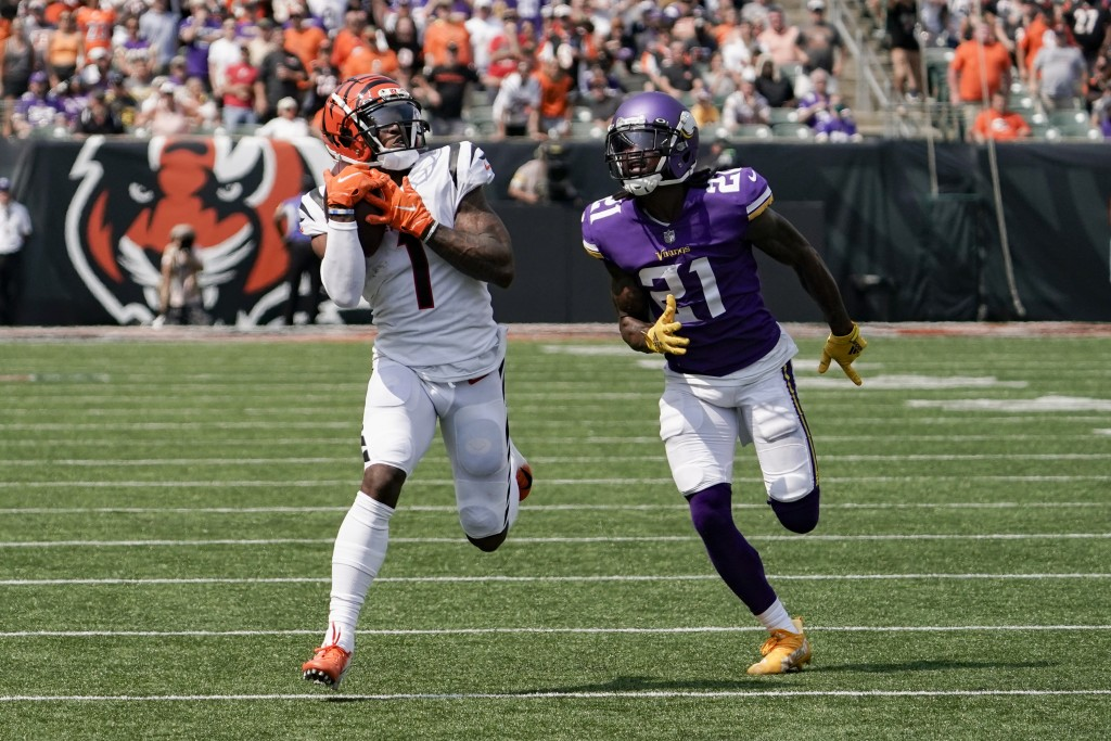 Cincinnati Bengals wide receiver Ja'Marr Chase (1) makes a catch and takes it in for a touchdown past Minnesota Vikings defensive back Bashaud Breelan...
