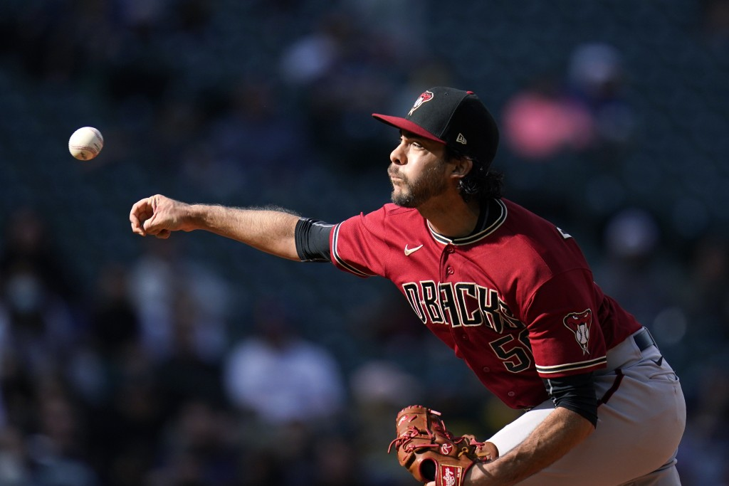 Arizona Diamondbacks relief pitcher Noe Ramirez throws against the Seattle Mariners in the eighth inning of a baseball game Sunday, Sept. 12, 2021, in...