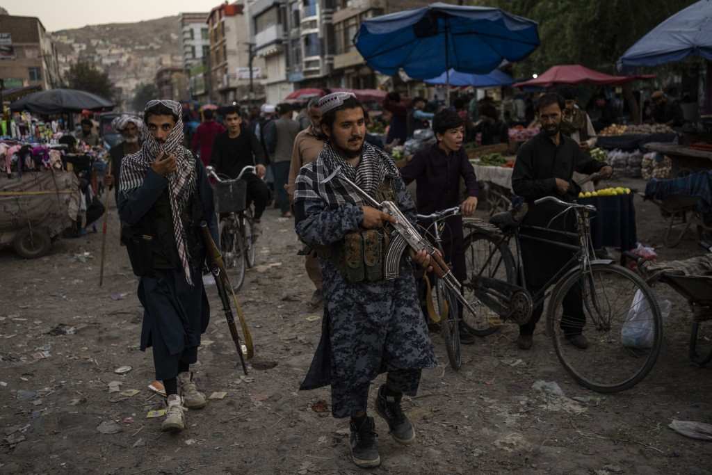 Taliban fighters patrol a market in Kabul's Old City, Afghanistan, Tuesday, Sept. 14, 2021. It is feared Afghanistan could further plunge toward famin...
