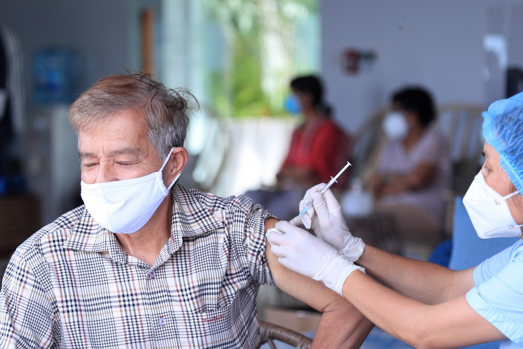 A man receives a shot of the Moderna COVID-19 vaccine in Vung Tau, Vietnam, Monday, Sep. 13, 2021. Vietnam is speeding up its vaccination program in a...
