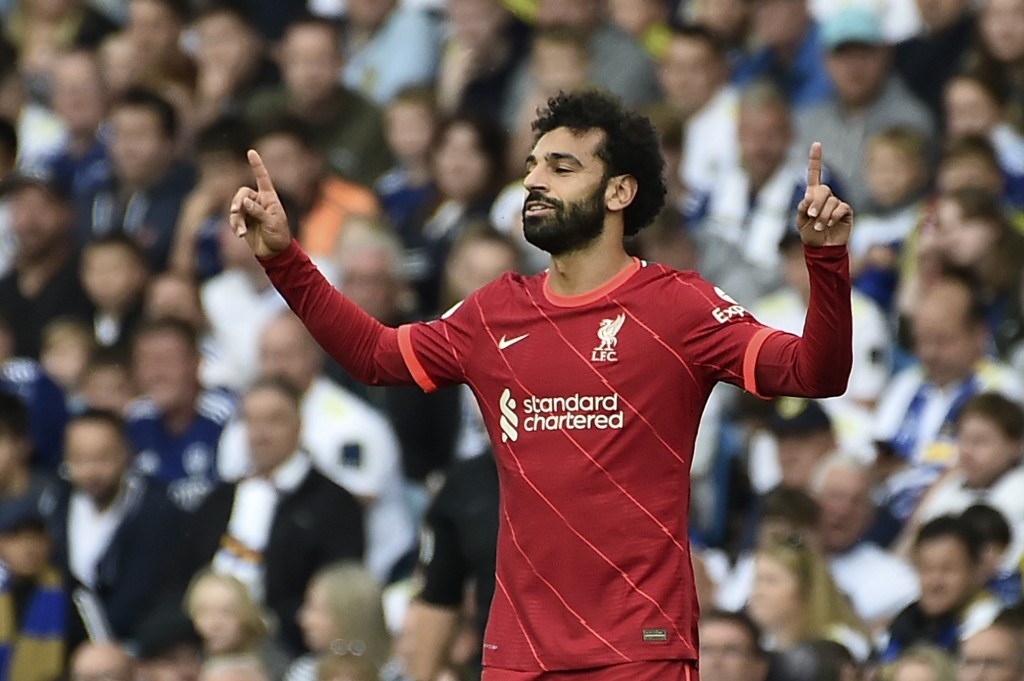 Liverpool's Mohamed Salah celebrates after scoring the opening goal during the English Premier League soccer match between Leeds United and Liverpool ...