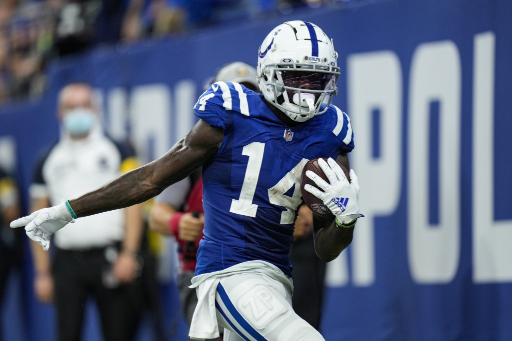 Indianapolis Colts wide receiver Zach Pascal (14) scores a touchdown against the Seattle Seahawks during the second half of an NFL football game in In...
