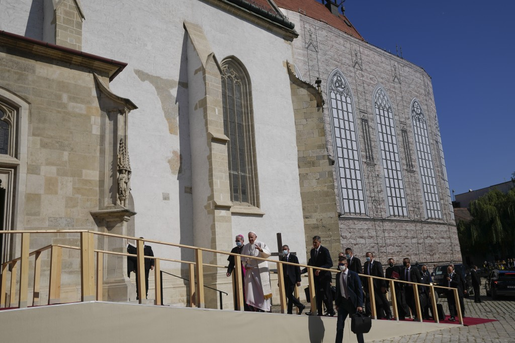 Pope Francis, white figure at center, arrives at the Cathedral of Saint Martin, in Bratislava, Slovakia, Monday, Sept. 13, 2021. Francis is on a four-...