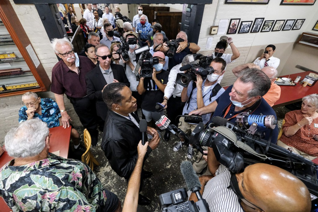 Republican conservative radio show host Larry Elder, is surrounded by media while he visiting Philippe The Original Deli during a campaign for the Cal...