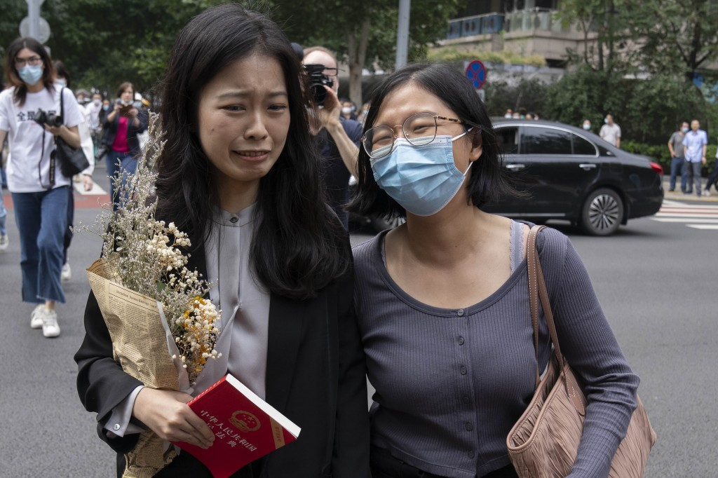 Zhou Xiaoxuan, left, a former intern at China's state broadcaster CCTV, reacts as she arrives to attend a court session at a courthouse in Beijing, Tu...